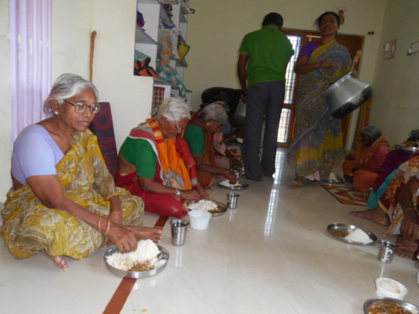 Donating_food_to_poor_senior_citizens_in_oldagehome_Large